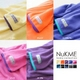 着るブランケット NuKME(ヌックミィ) 袖付き毛布 ターコイズブルー 写真4