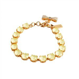 KATE SPADE(ケイトスペード) WBRUB814-797 Light Yellow リボンチャーム付 スワロフスキークリスタル ブレスレット Fancy That Bracelet h01