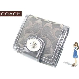 COACH(コーチ) ハンプトンズ シグネチャー ターンロック フレンチ 財布 ブラウン 42428 - 拡大画像